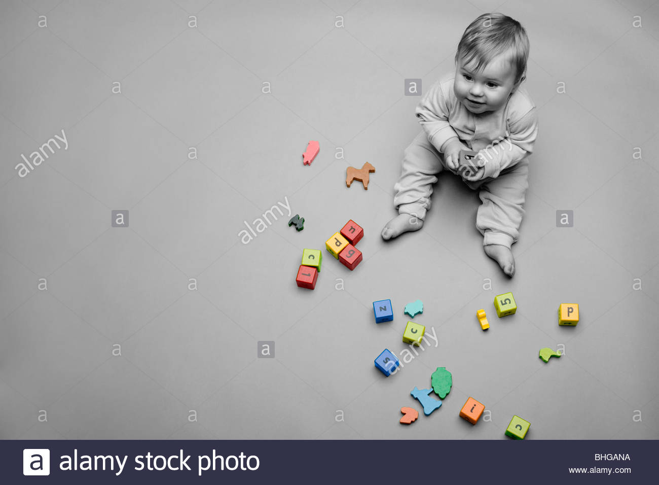 Baby with building blocks - Stock Image