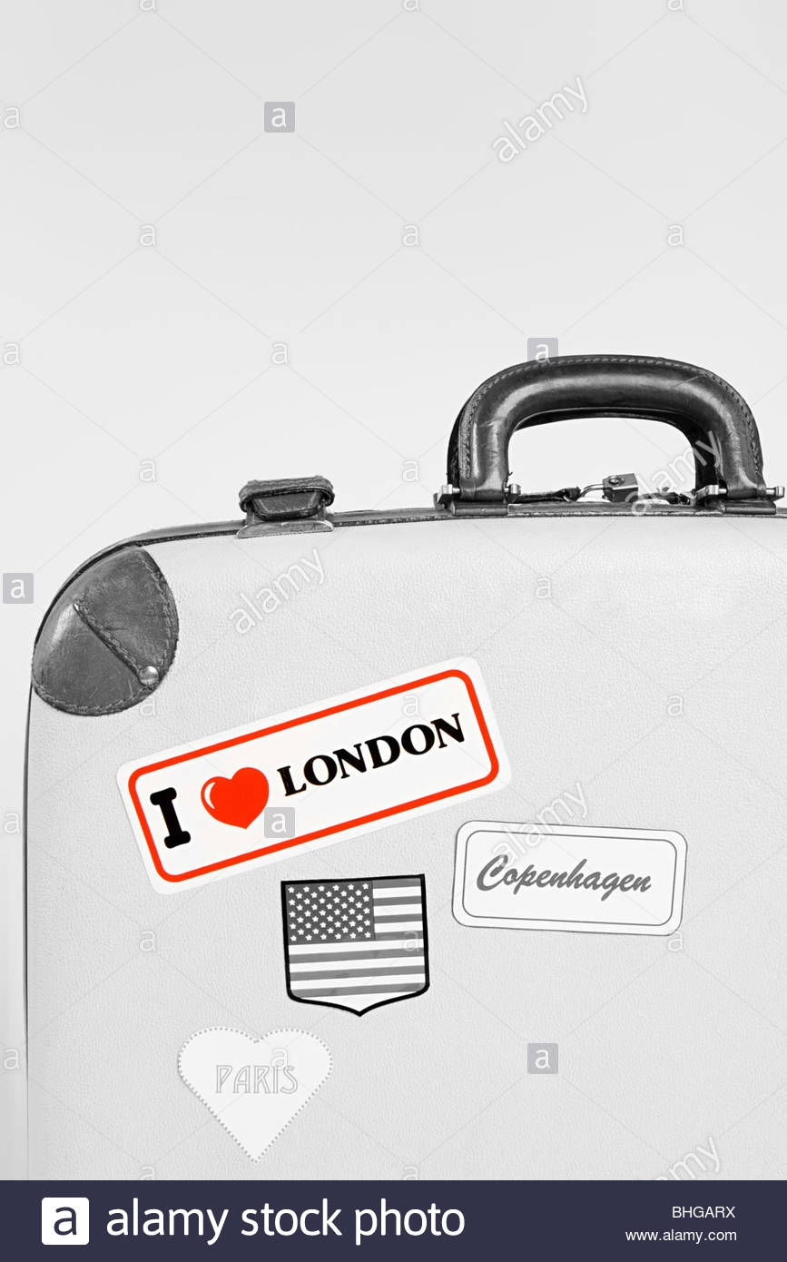 Stickers on a suitcase - Stock Image