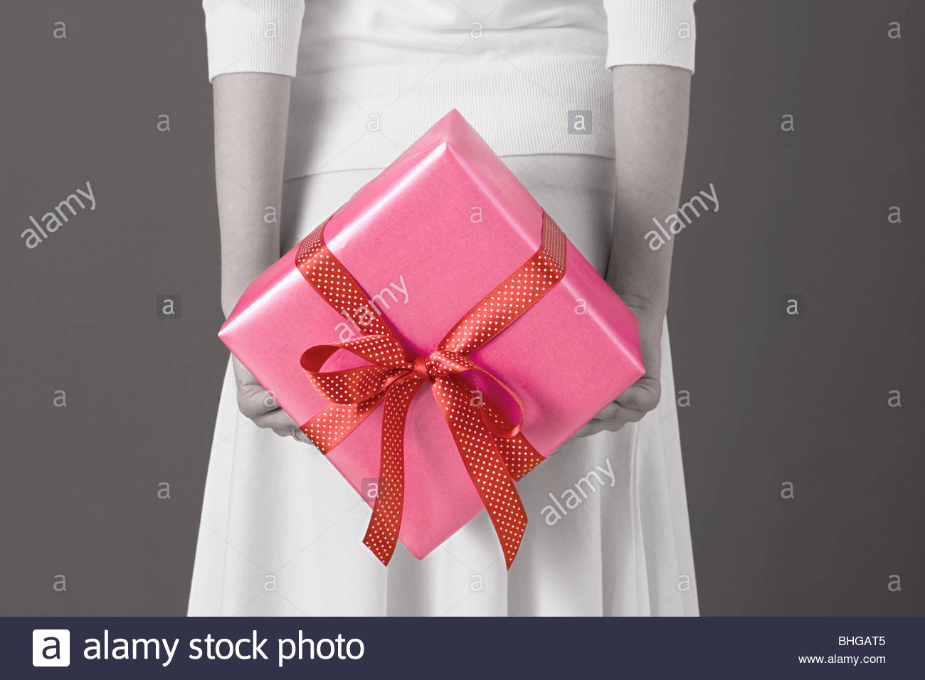 Woman holding a gift - Stock Image