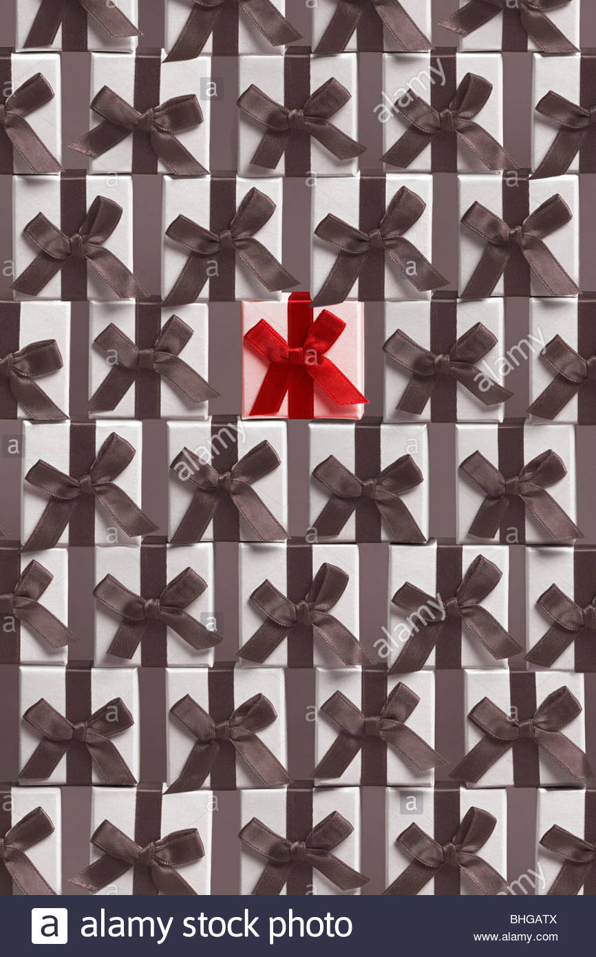 Red gift bow standing out from black and white - Stock Image