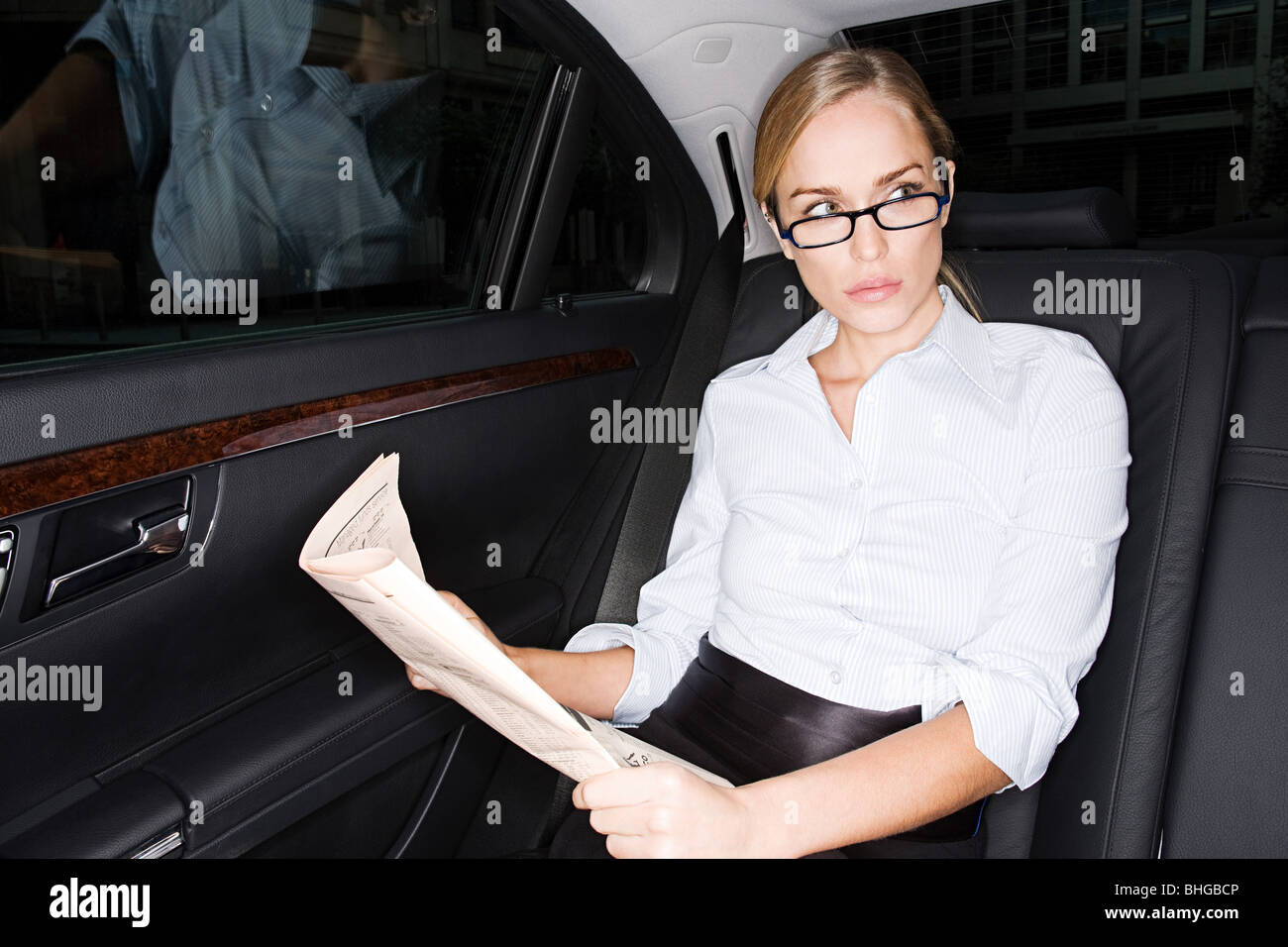 Businesswoman in the back of a car - Stock Image