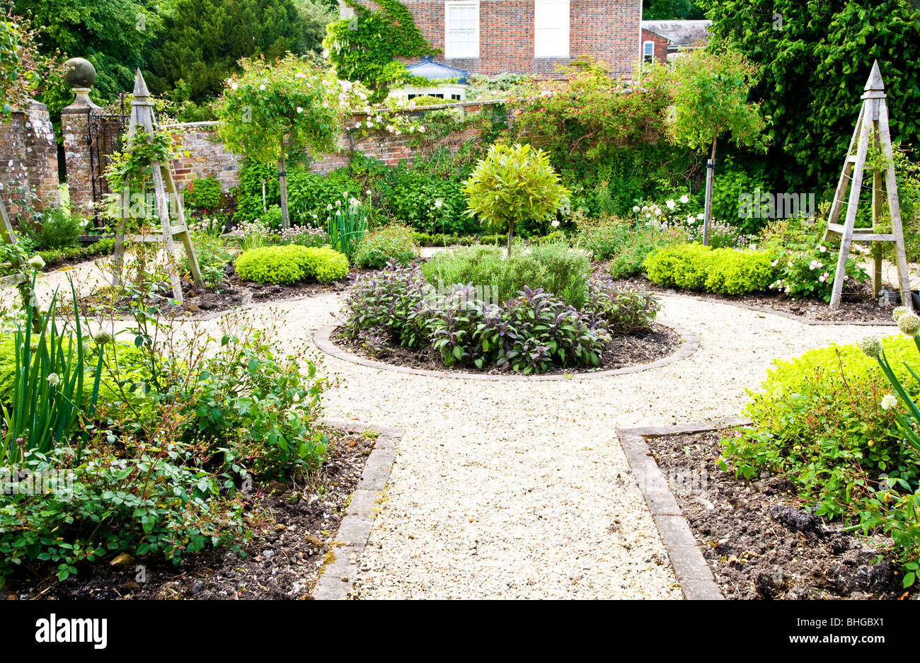 A formal herb or kitchen garden in the grounds of an English country house or manor - Stock Image