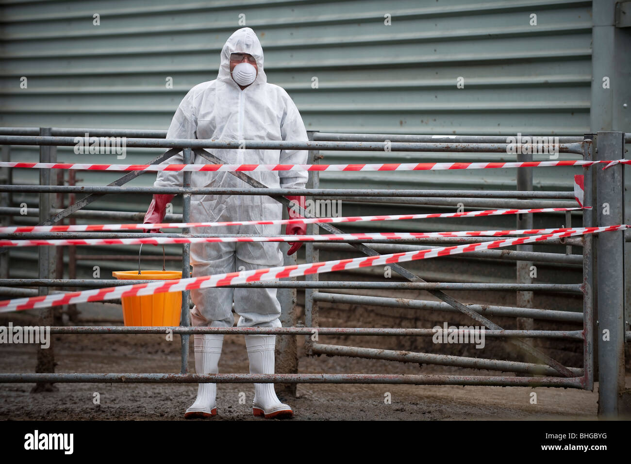 bio hazard worker on farm - Stock Image