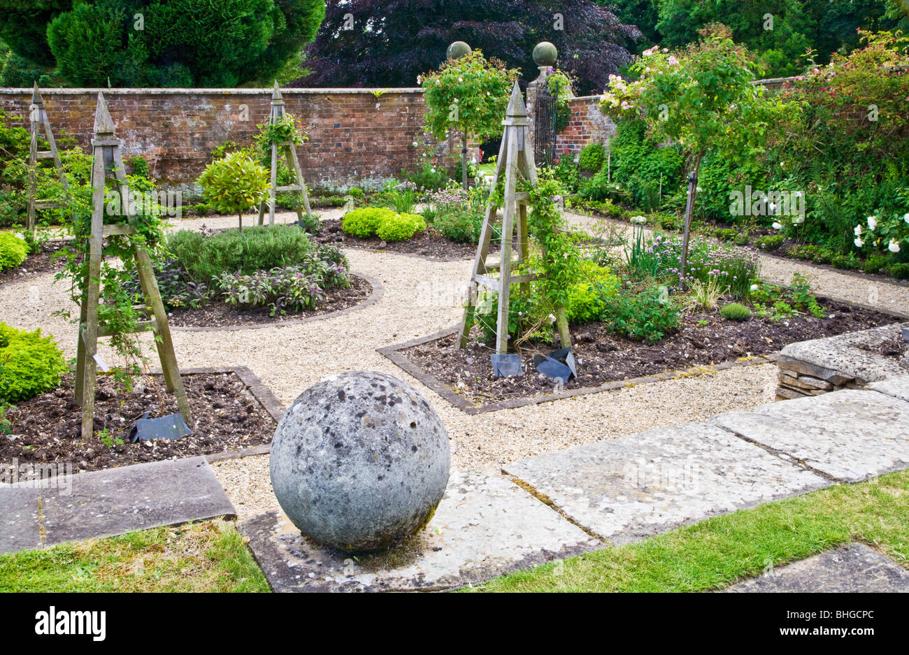 A formal walled herb or kitchen garden in the grounds of an English country house. - Stock Image