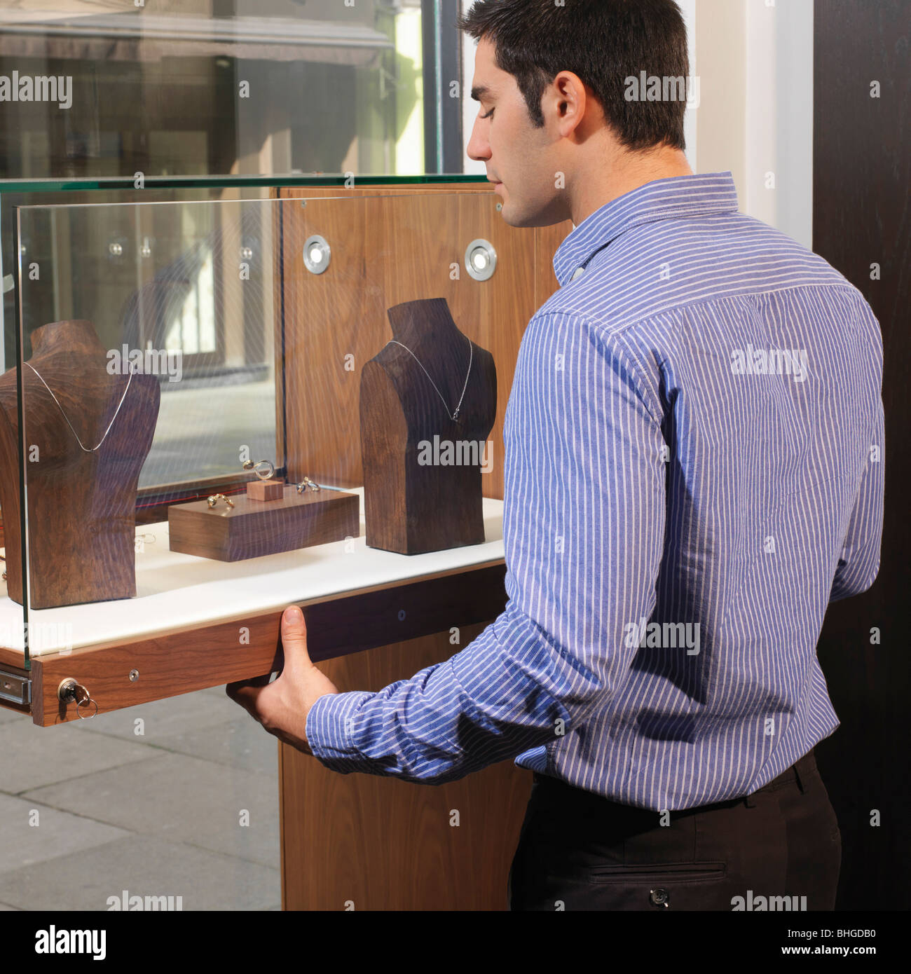 man opening/closing jewelry display - Stock Image