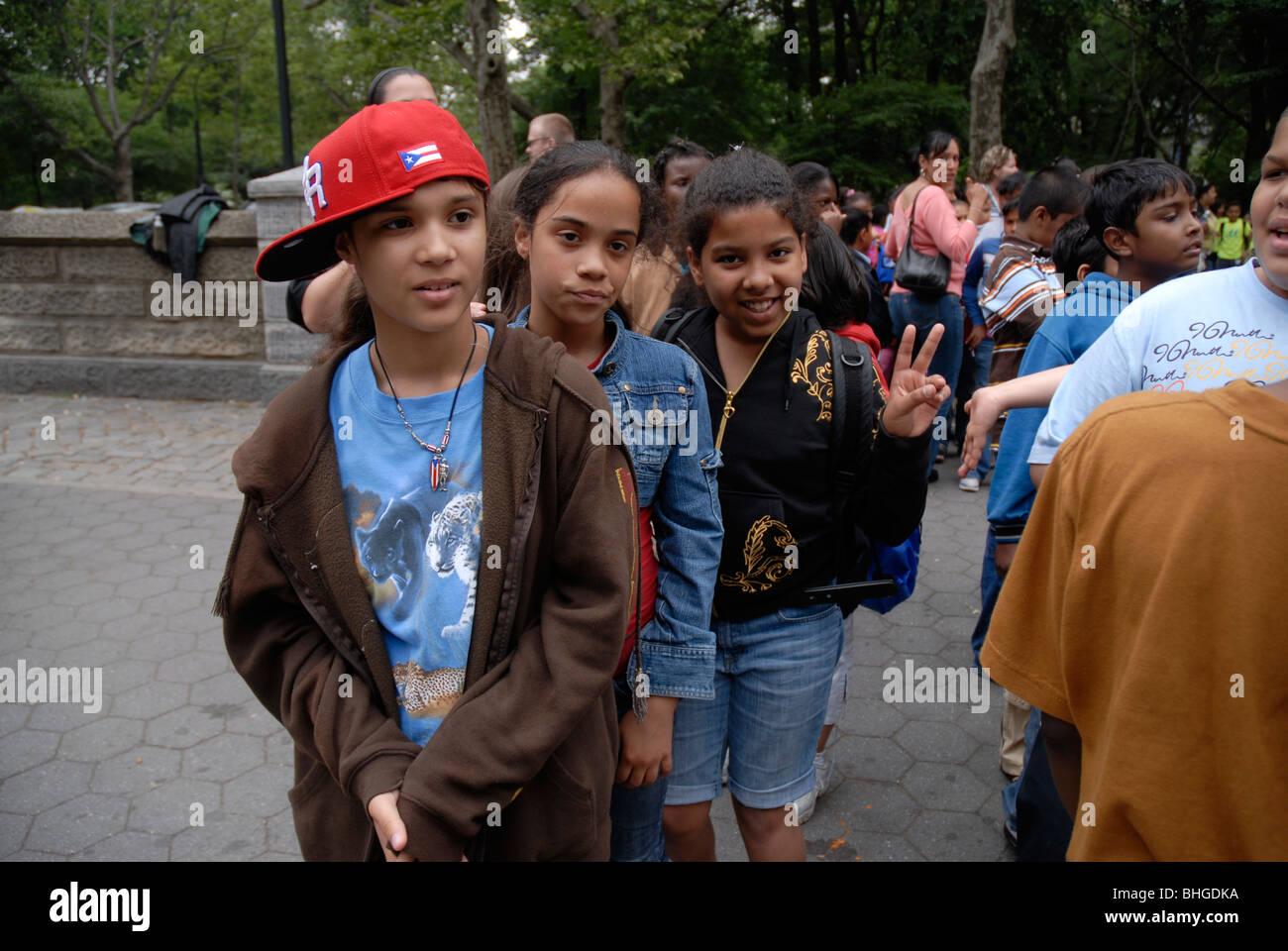 New York City School children waiting for bus to take them home - Stock Image
