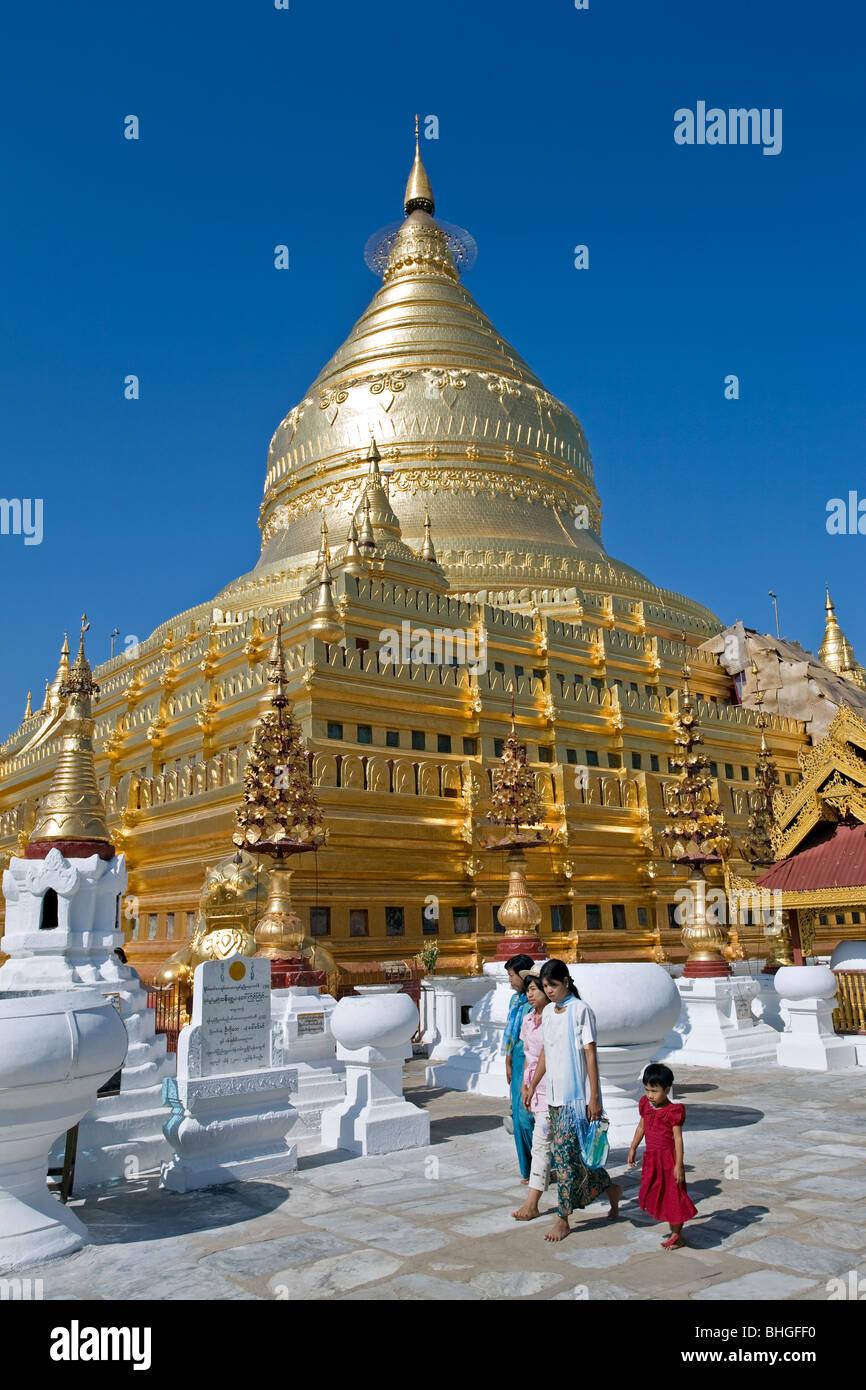 People at Shwezigon Paya. Nyaung U. Bagan. Myanmar Stock Photo