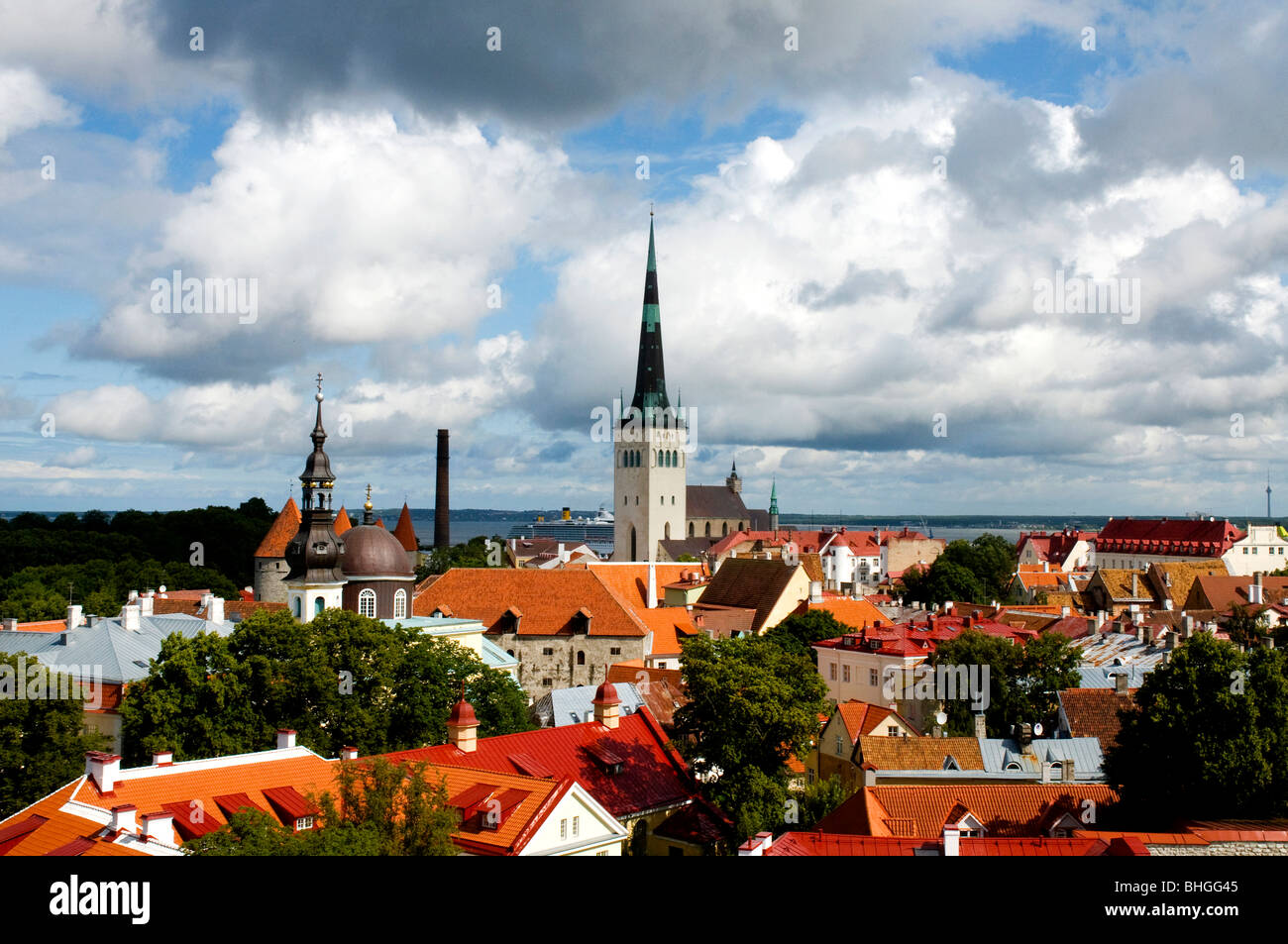 View of St Olav's Church and surrounding rooftops, Tallinn, Estonia - Stock Image