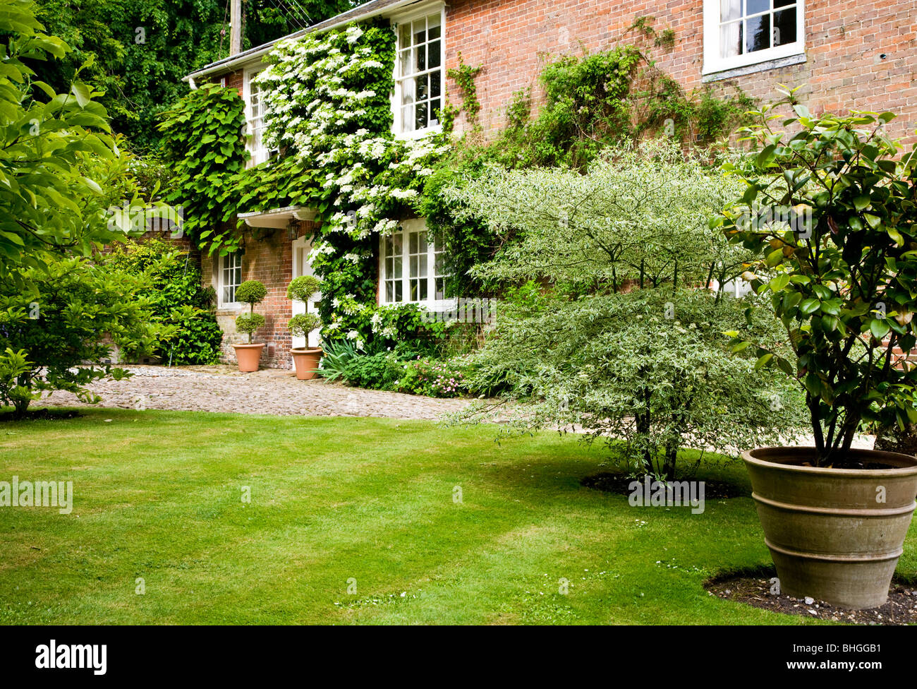 A pretty English country house in summer in England UK - Stock Image