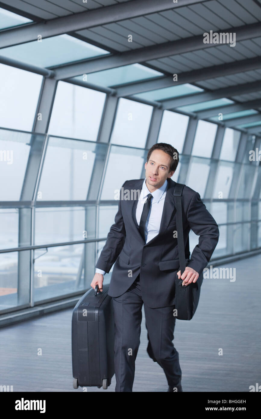 businessman with case hurrying - Stock Image