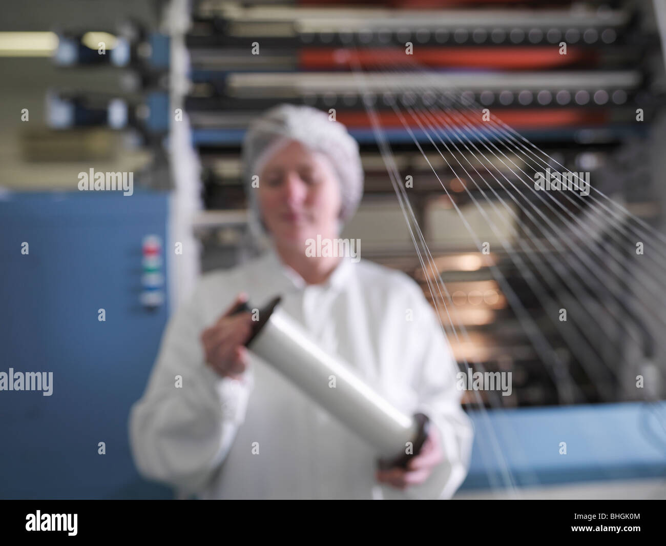 Technician Weaving Medical Product - Stock Image