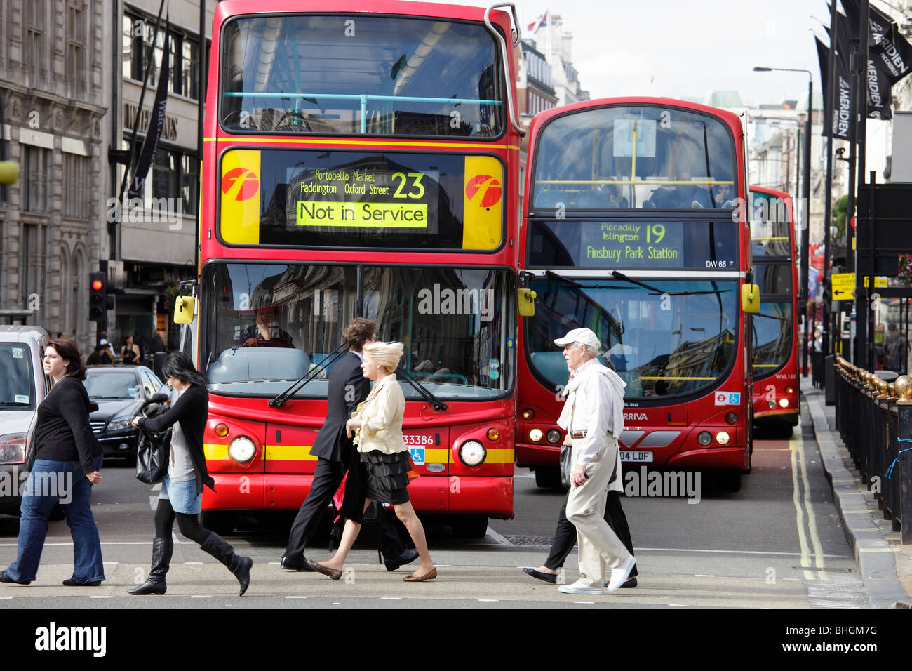 Pedestrians and busses in Picadilly, London - Stock Image