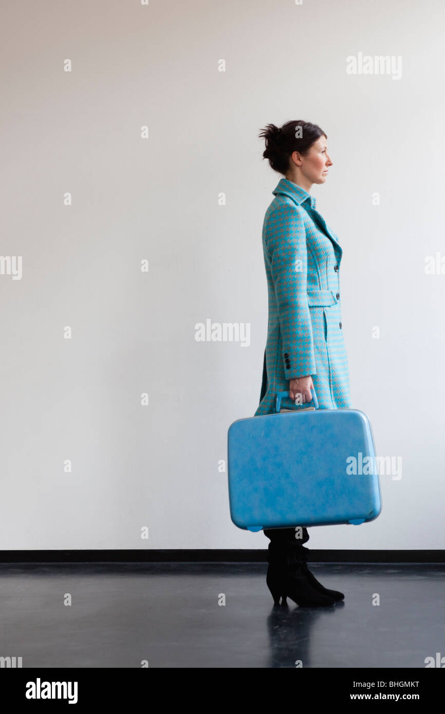 woman with suitcase - Stock Image