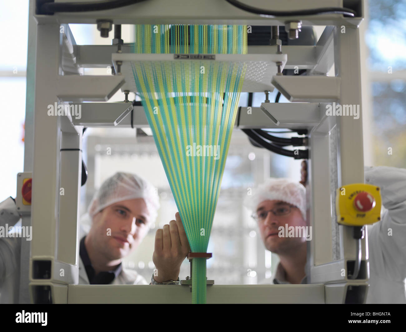 Technicians Weaving Medical Product - Stock Image