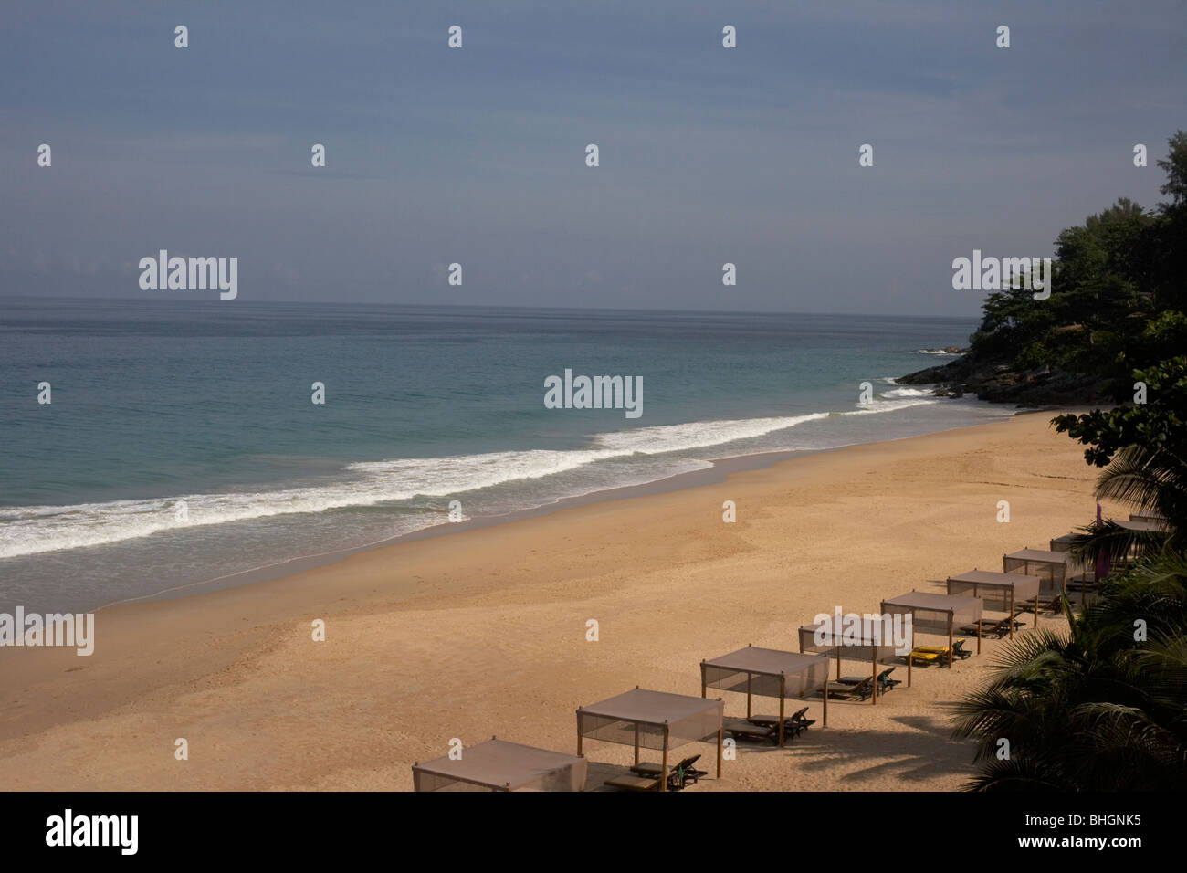 deserted beach with sunbeds - Stock Image