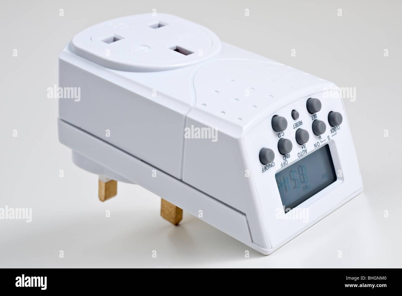 24 hour digital UK mains electrical household socket timer - Stock Image