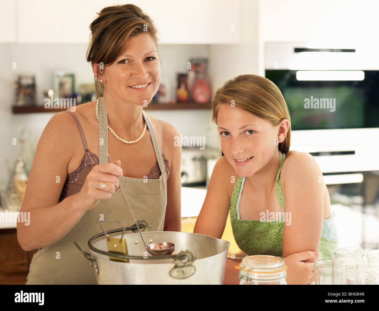 mother and daughter making jam - Stock Image