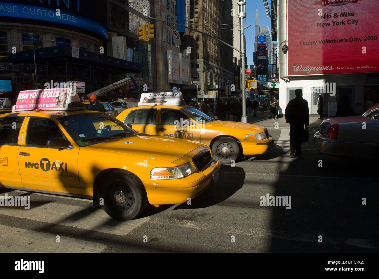 Pedestrians maneuver through gridlocked traffic in Times Square in New York on Friday, February 12, 2010. (© - Stock Image