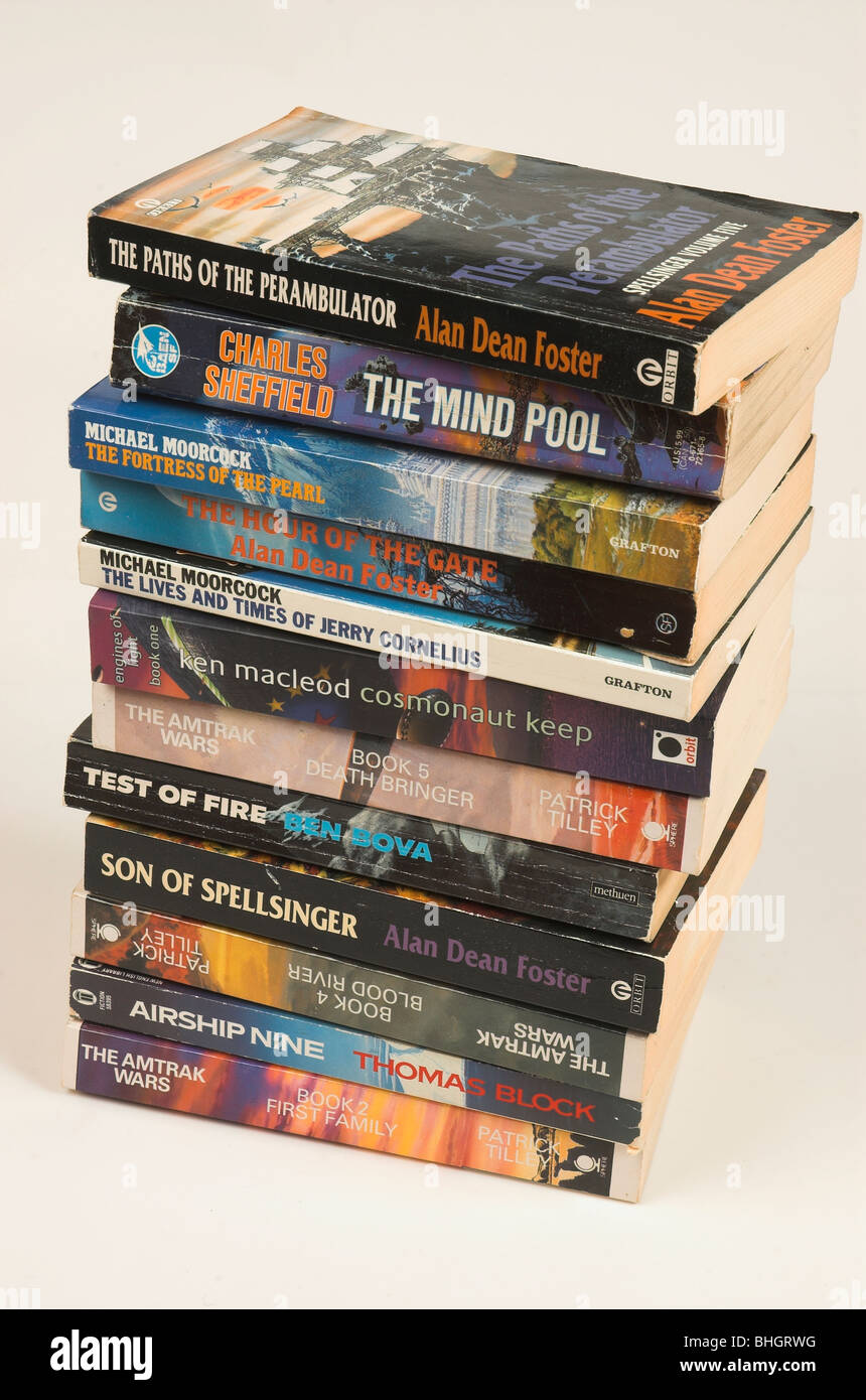 Stack of science fiction paperback books - Stock Image