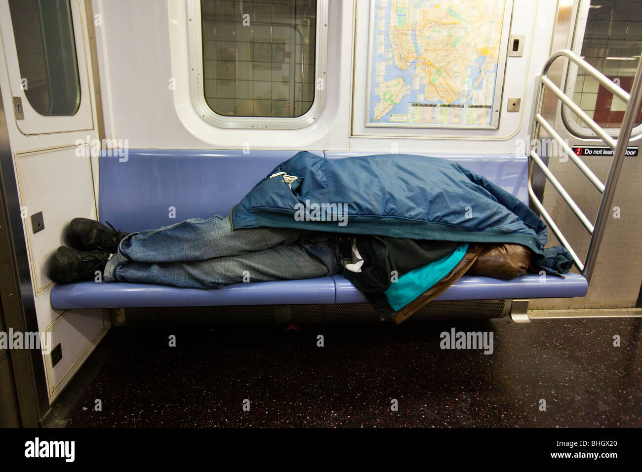 homeless man sleeping on the subway in new york city stock photo 28031192 alamy. Black Bedroom Furniture Sets. Home Design Ideas