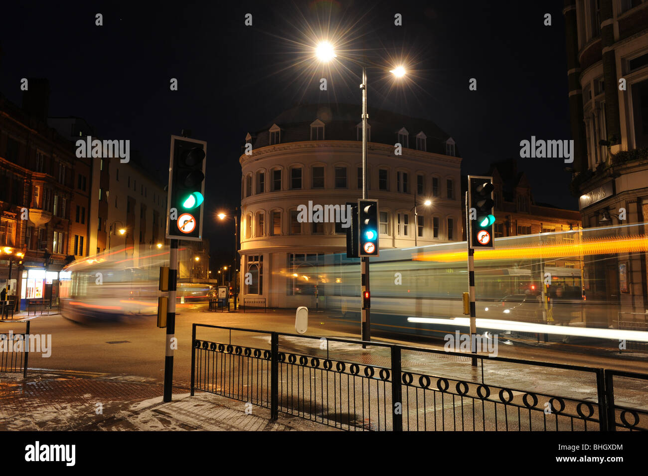 Traffic lights at night at Lichfield Street junction Wolverhampton the site of Britains first ever traffic lights - Stock Image