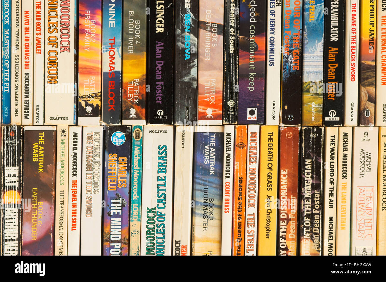 Piles of old second hand science fiction paperback books - Stock Image