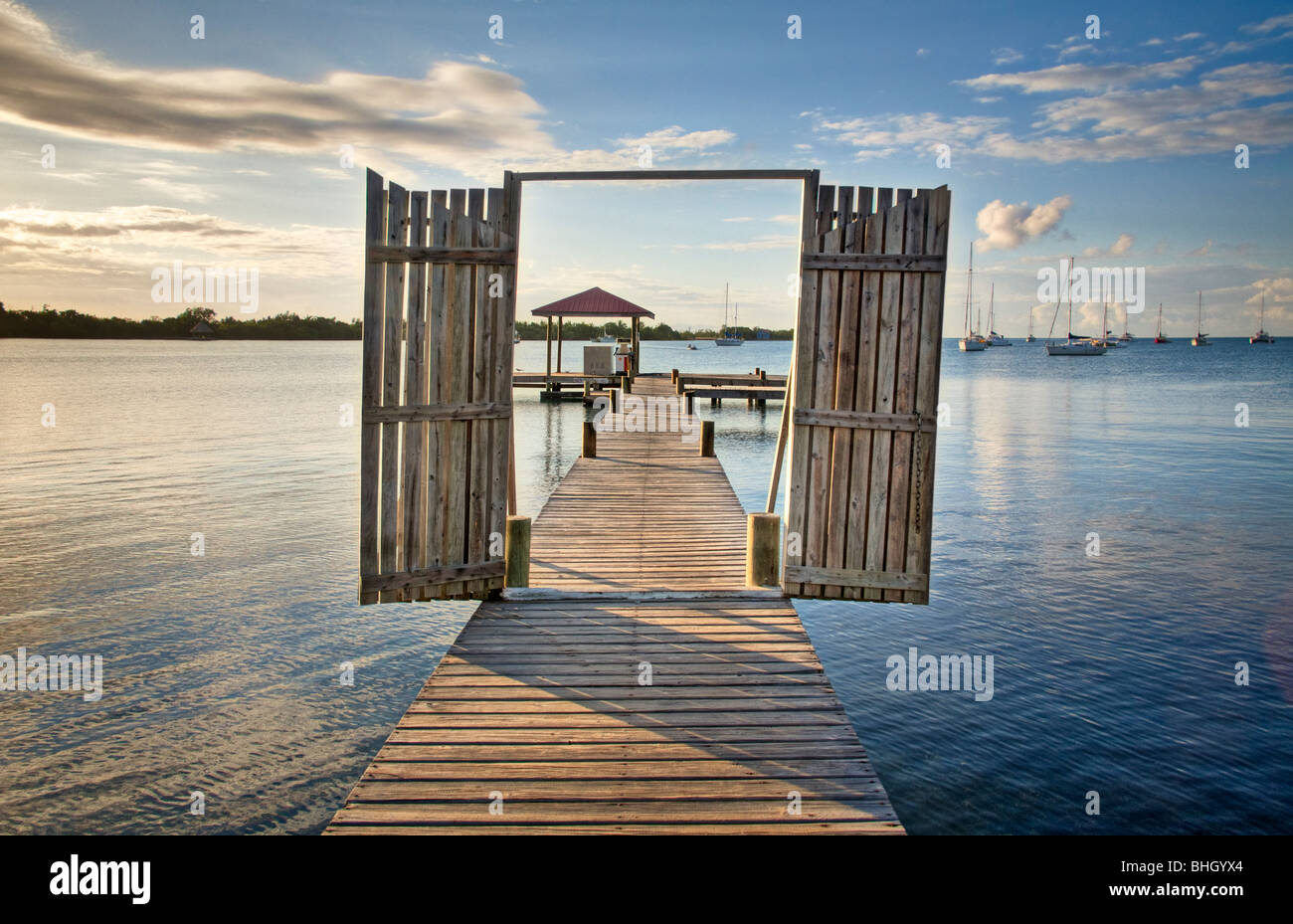 main dock at sunrise in Placencia, Belize - Stock Image