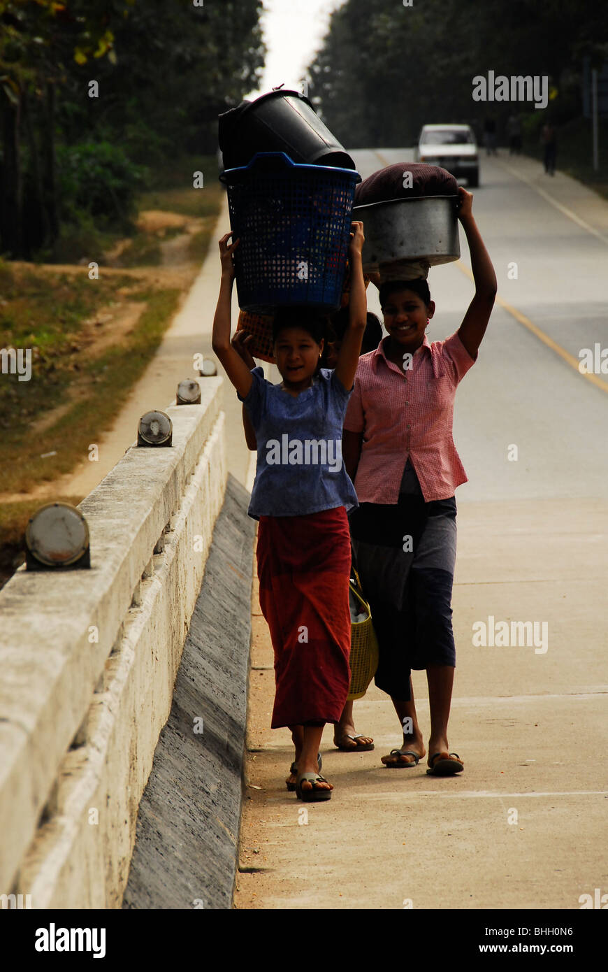 karen refugee's going to stream to wash clothes, mae la refugee camp , near mae sot , north thailand - Stock Image
