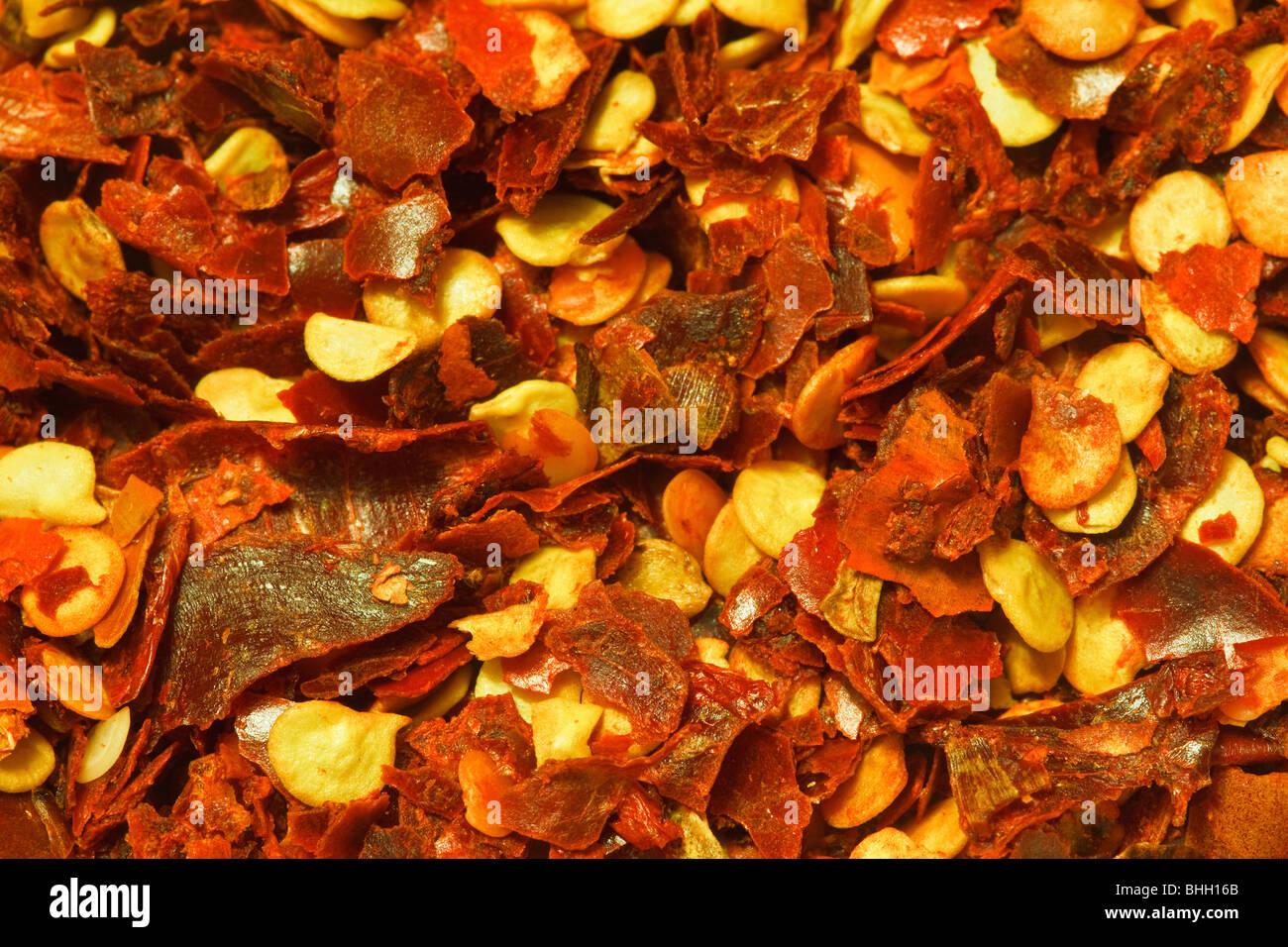 Macro image of crushed chili pepper - Stock Image