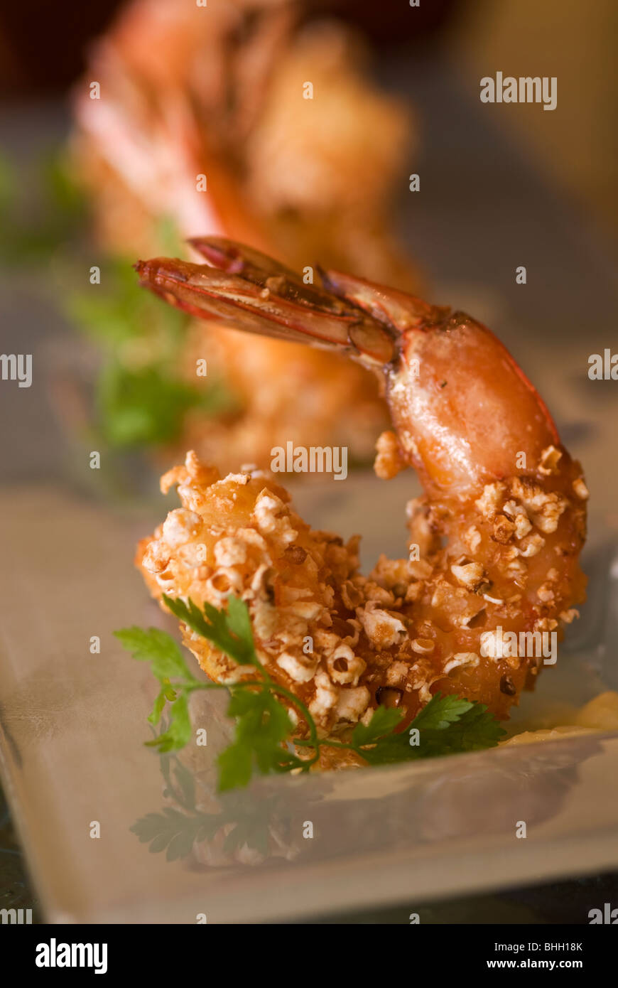 Popcorn Shrimp jumbo Mexican prawns with sea salt scented drawn butter at restaurant in Southern California - Stock Image