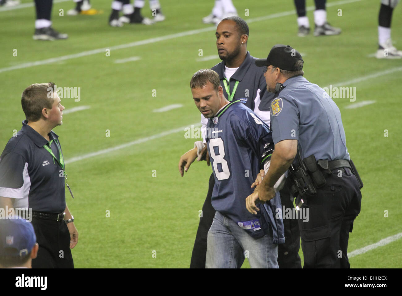 Drunk football fan arrested for running out on the field during a live NFL game at Qwest Field during Seahawks vs - Stock Image