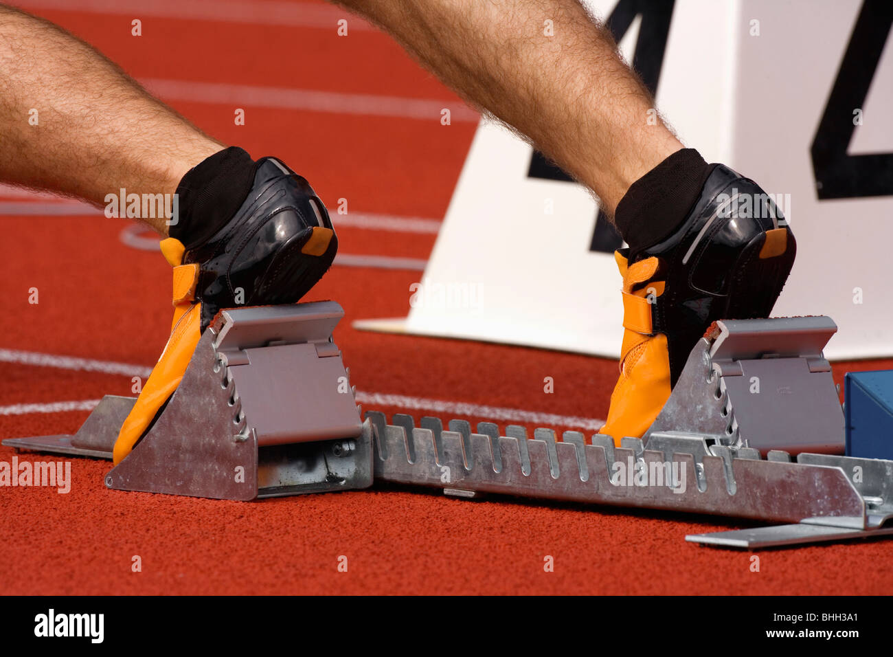sport - runner at starting block in running competition - Stock Image