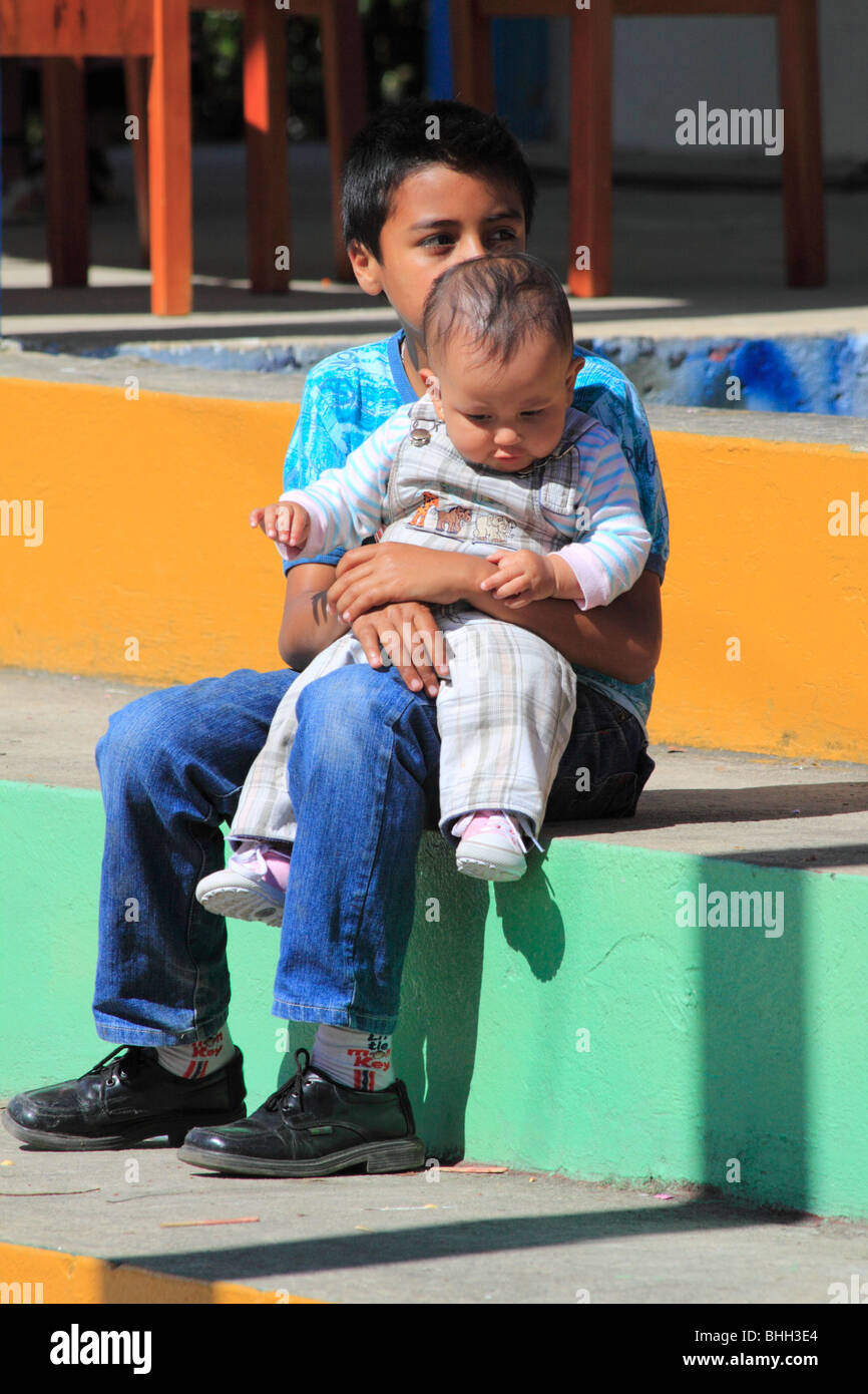 Child holding his baby brother. Caldas, Boyacá, Colombia, South America - Stock Image
