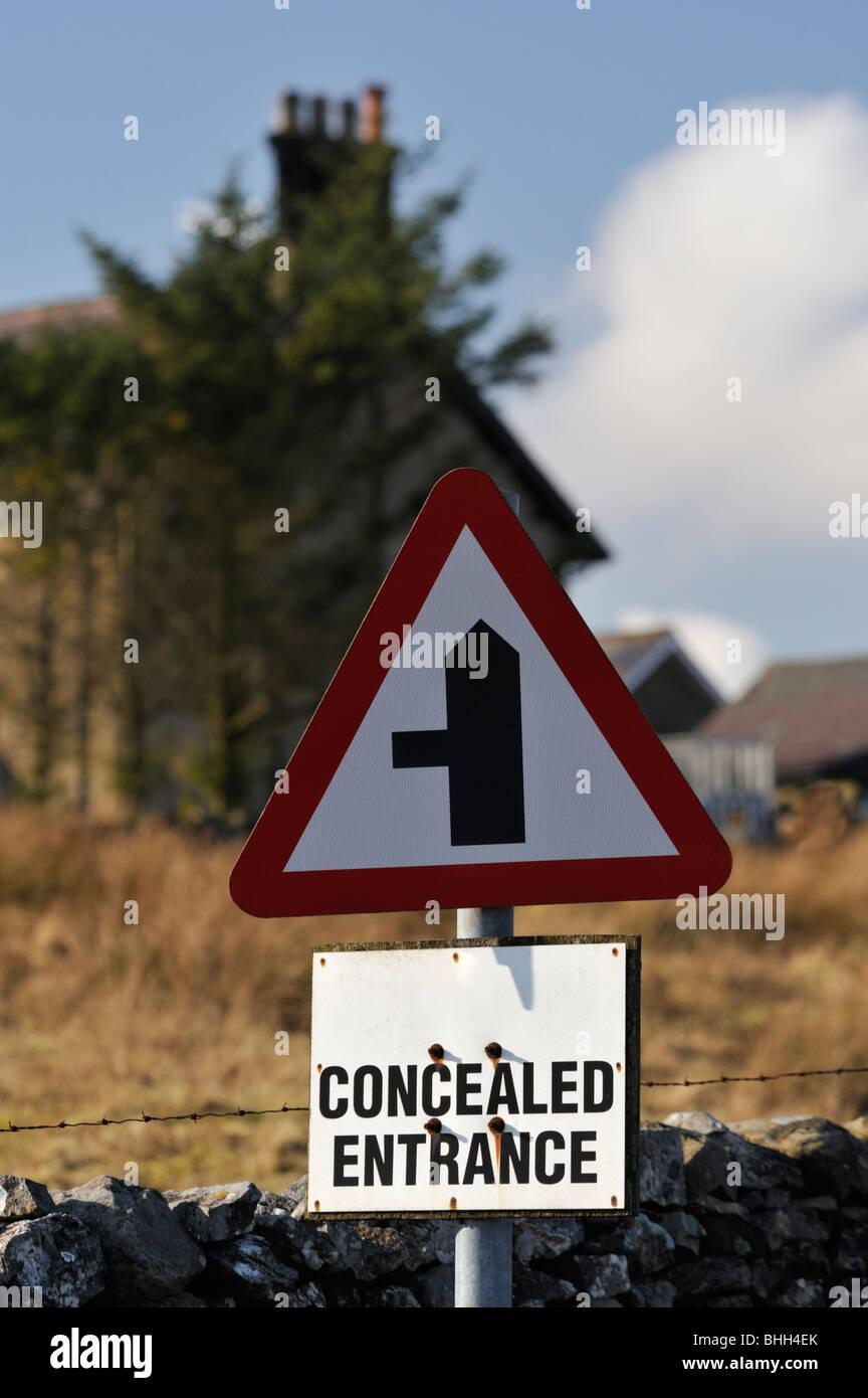 Road sign 'CONCEALED ENTRANCE'. Gauber Road, Yorkshire Dales National Park, Yorkshire, England, United Kingdom, - Stock Image