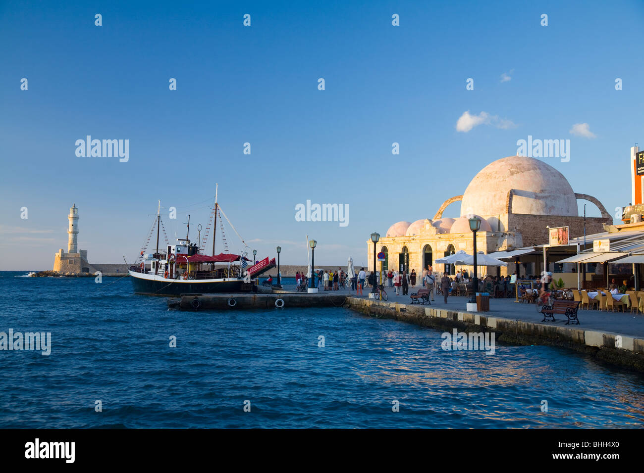 The Venetian harbour and seafront in Chania, including the Mosque of the Janissaries. Crete, Greece. - Stock Image