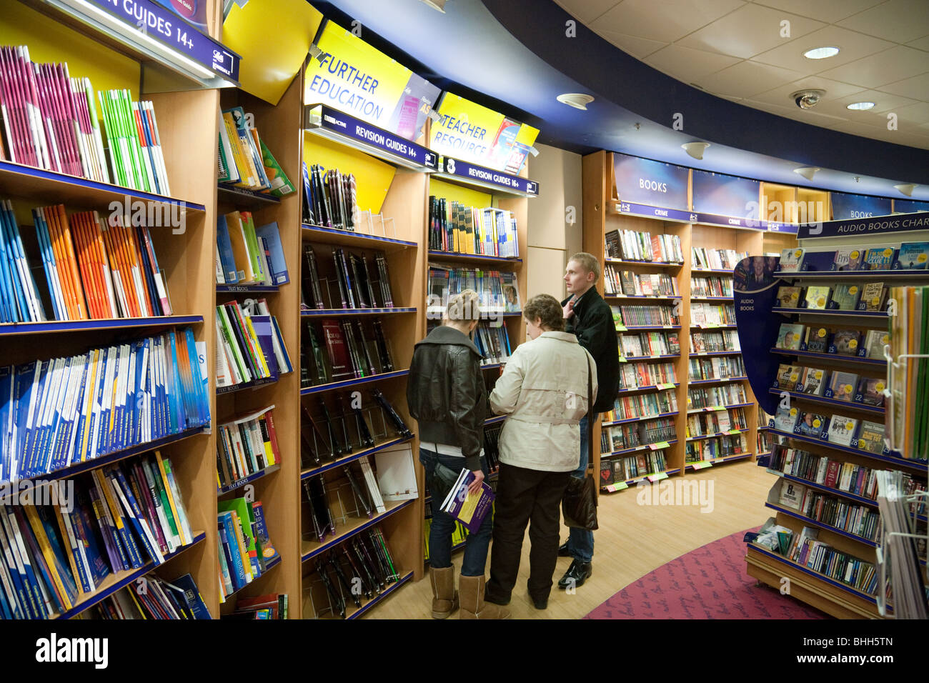 Customers looking at Educational Books, WH Smiths bookstore, Bluewater Shopping Mall, Kent UK - Stock Image