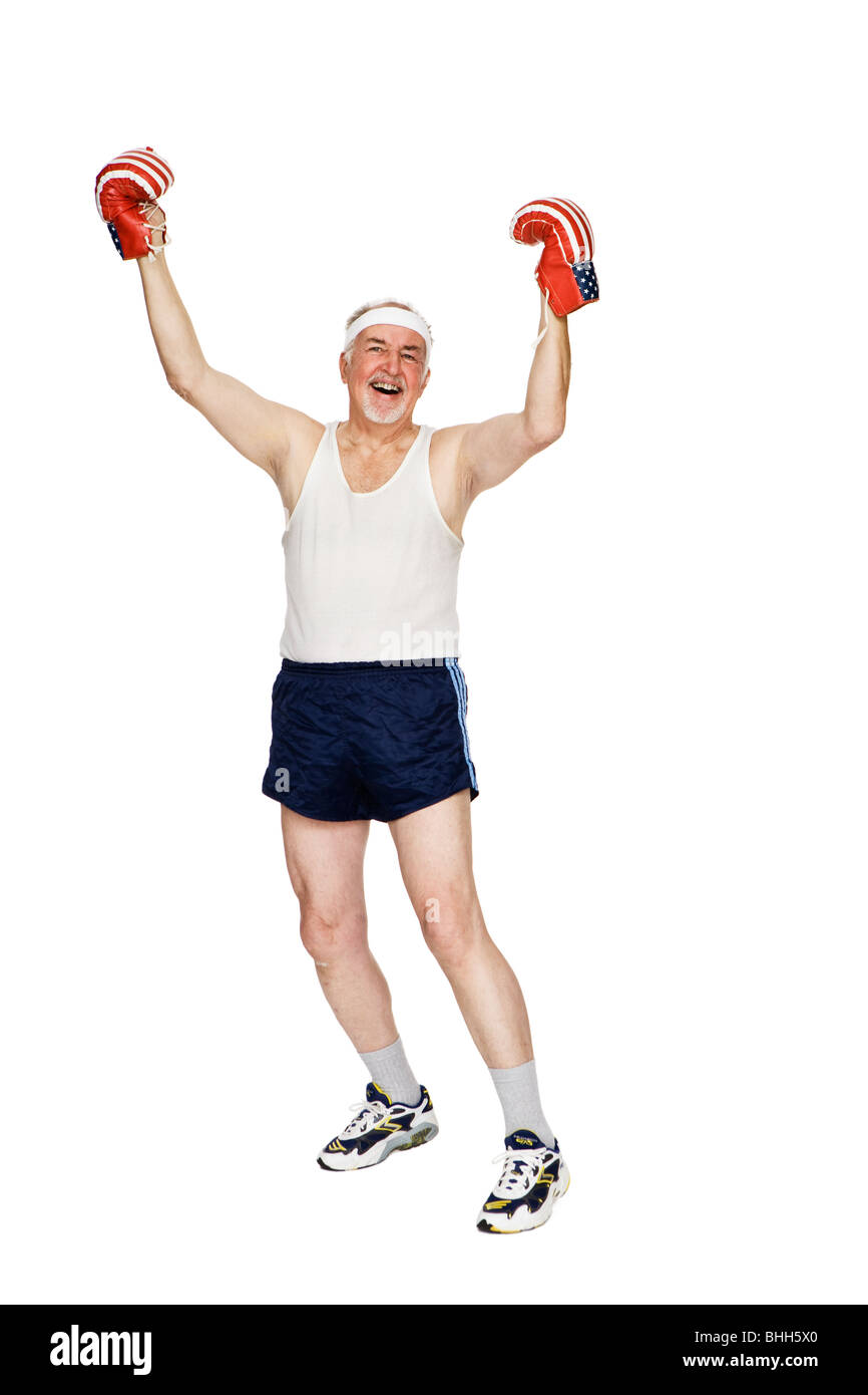 Senior man with boxing gloves. - Stock Image