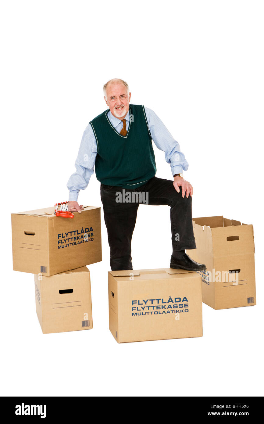Senior man carrying boxes. - Stock Image
