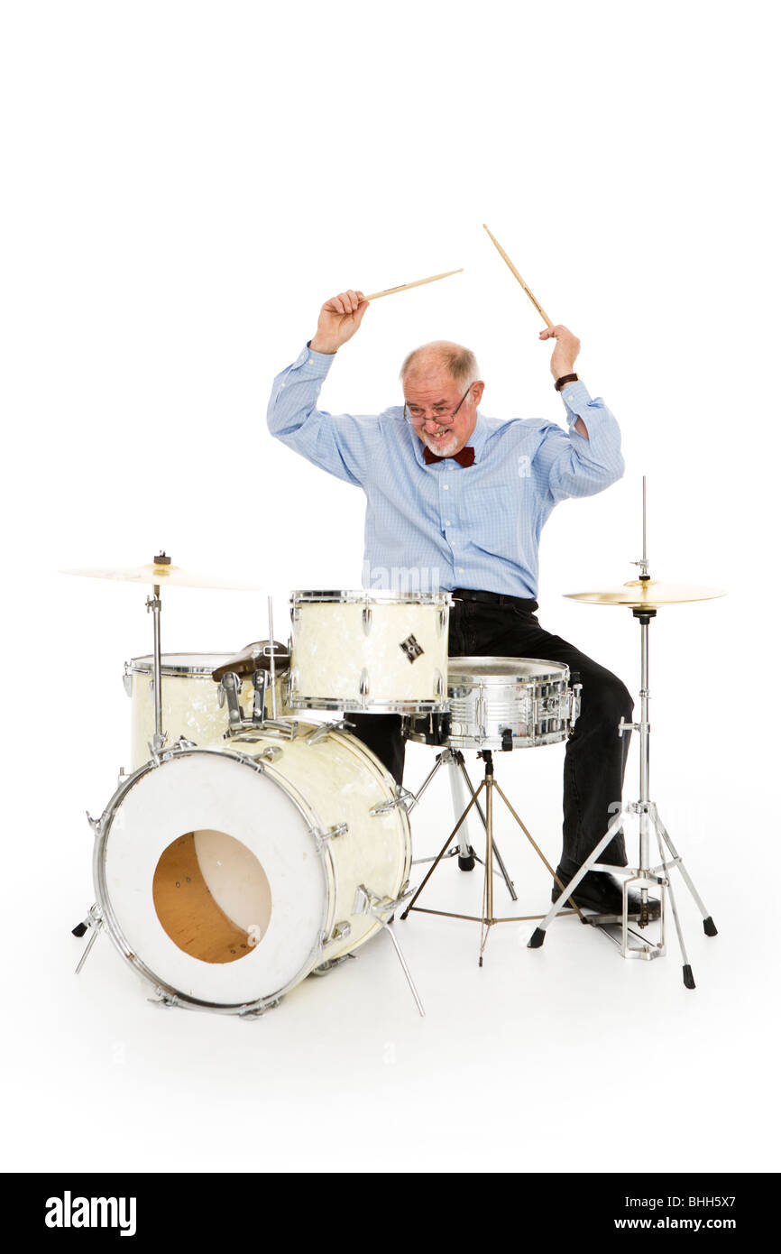 Senior man playing the drums. - Stock Image