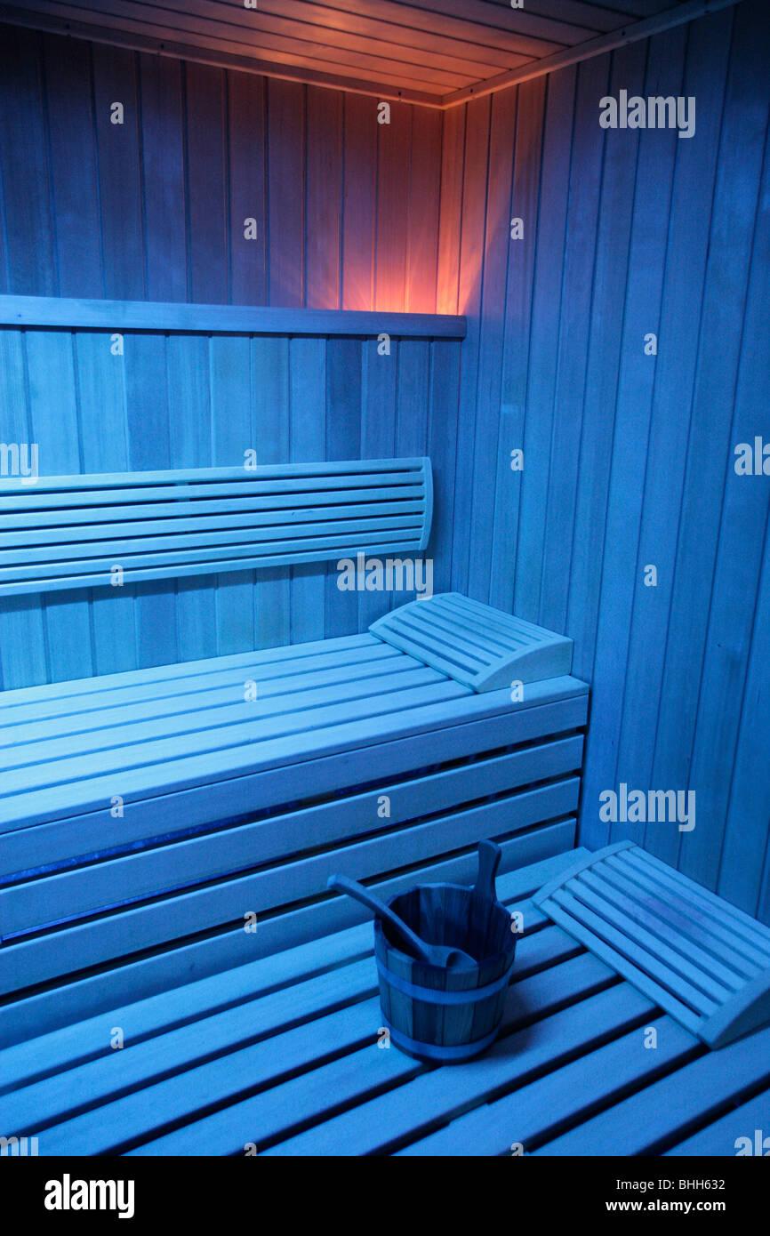 A sauna in blue light, Sweden. - Stock Image