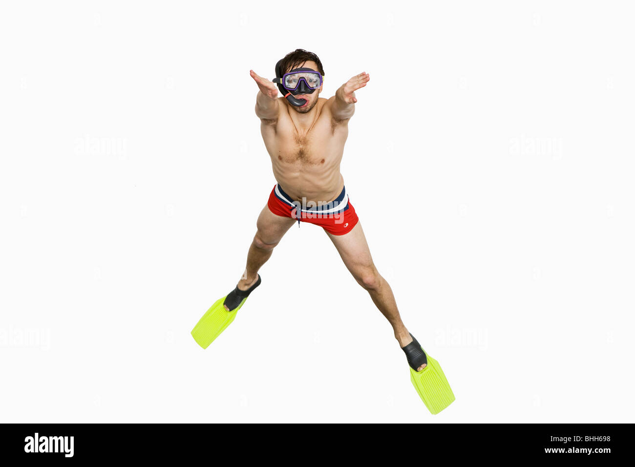 Young man with diving flippers and goggles. - Stock Image