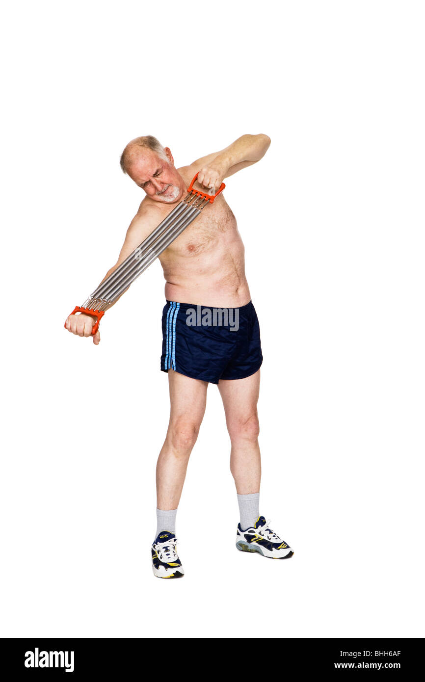 Senior man with a training apparatus. - Stock Image