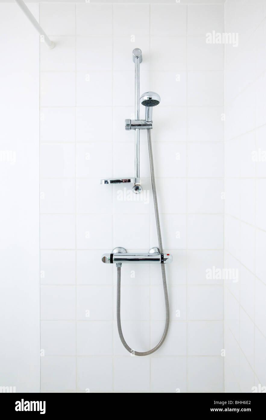 mixer shower in bathroom - Stock Image