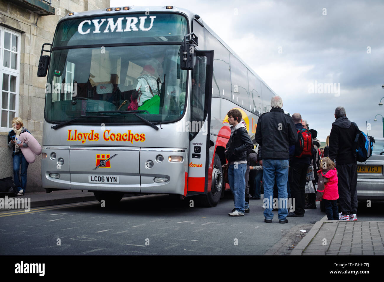 Rail passengers boarding a replacement bus service at Aberystwyth railway station, Wales UK - Stock Image