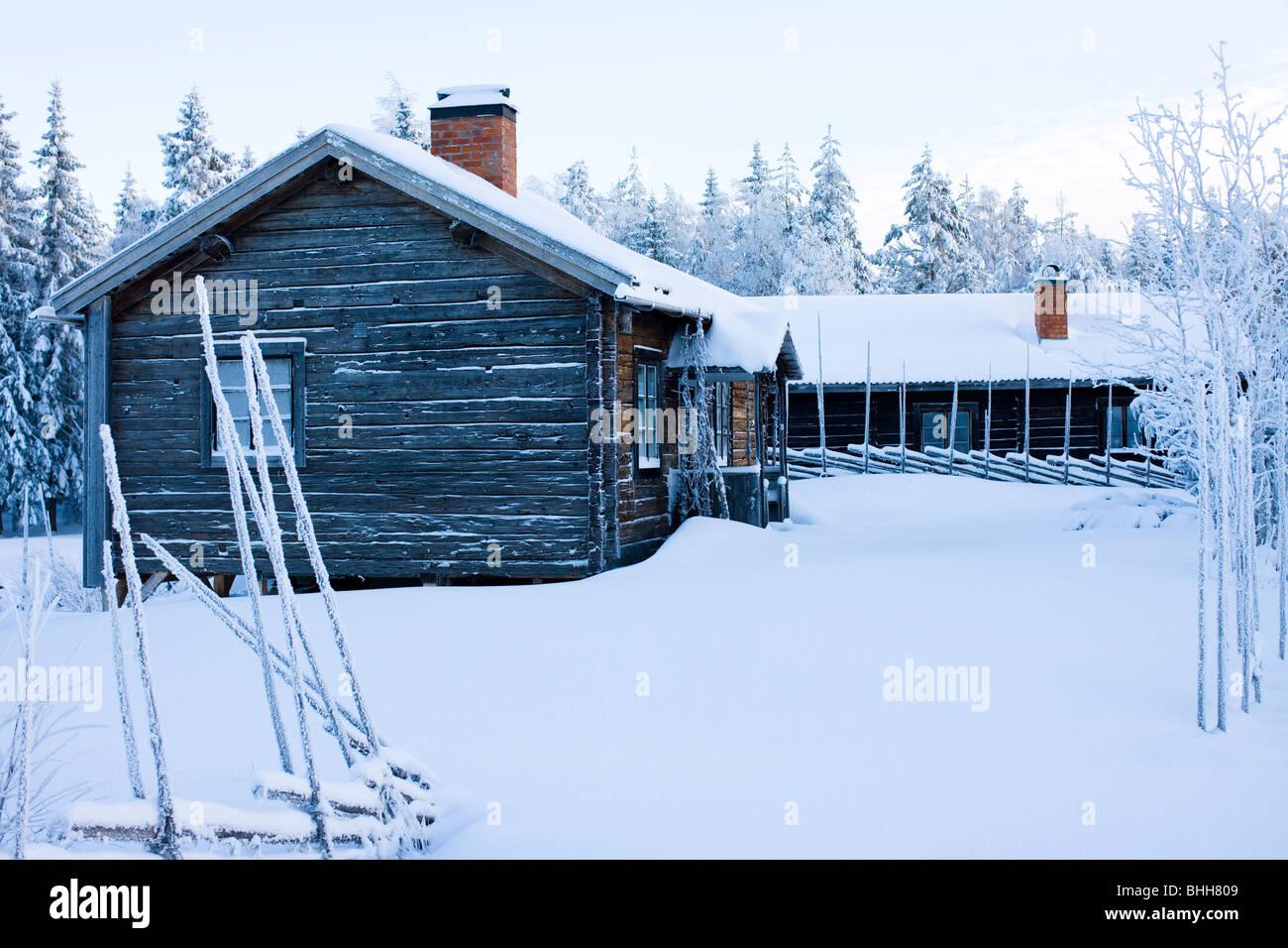 Hut in a wintry landscape, Sweden. - Stock Image