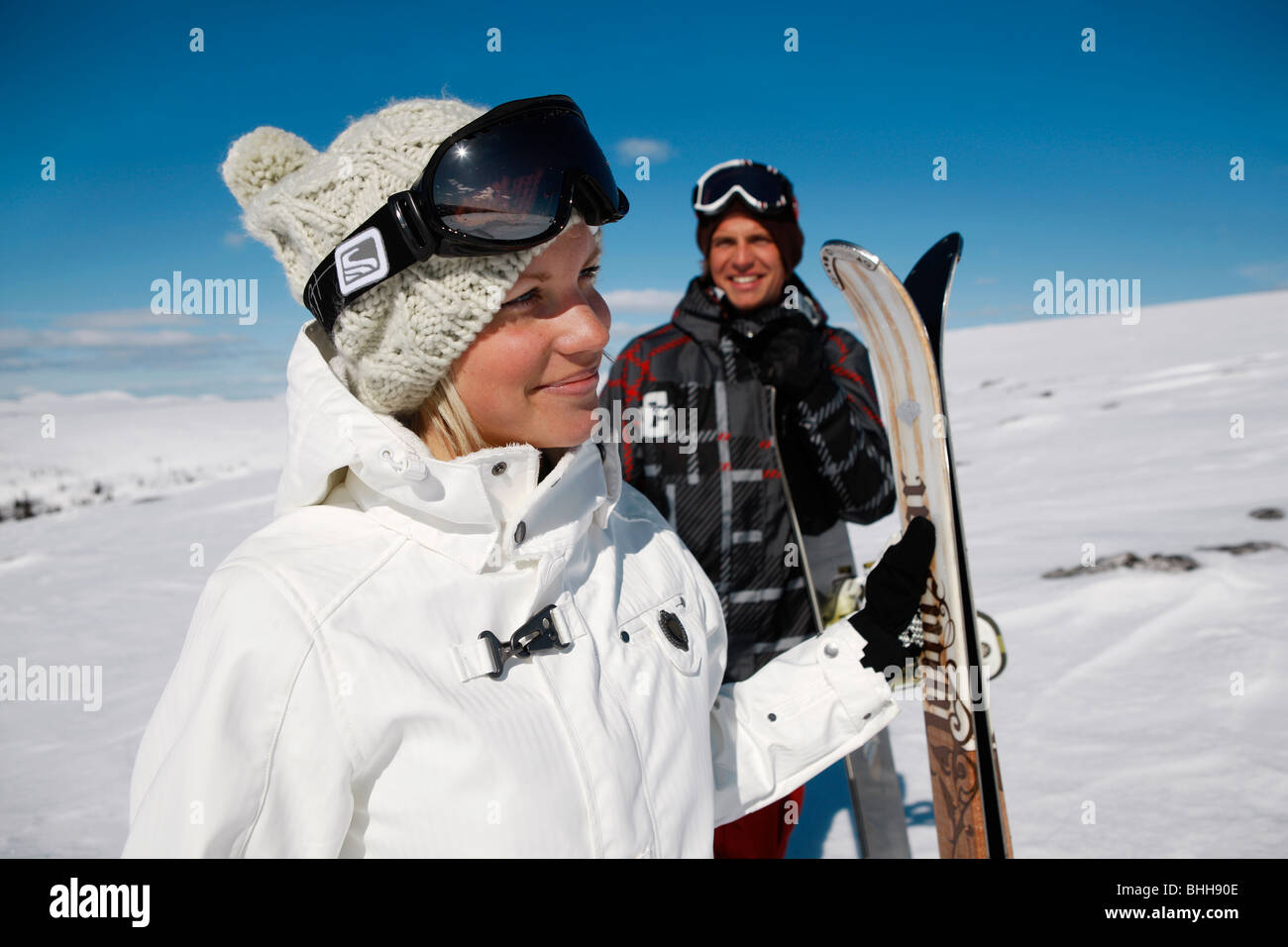 Young man and woman skiing, Sweden. - Stock Image