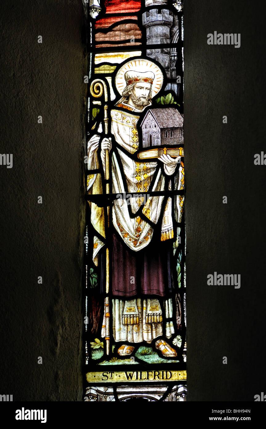 St. Wilfrid stained glass, St. Wilfrid`s Church, Screveton, Nottinghamshire, England, UK - Stock Image
