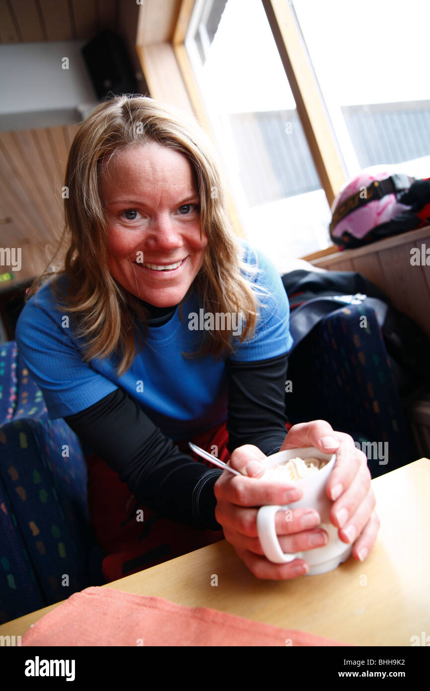 A woman with a cup of hot chocolate and whipped cream, Sweden. - Stock Image