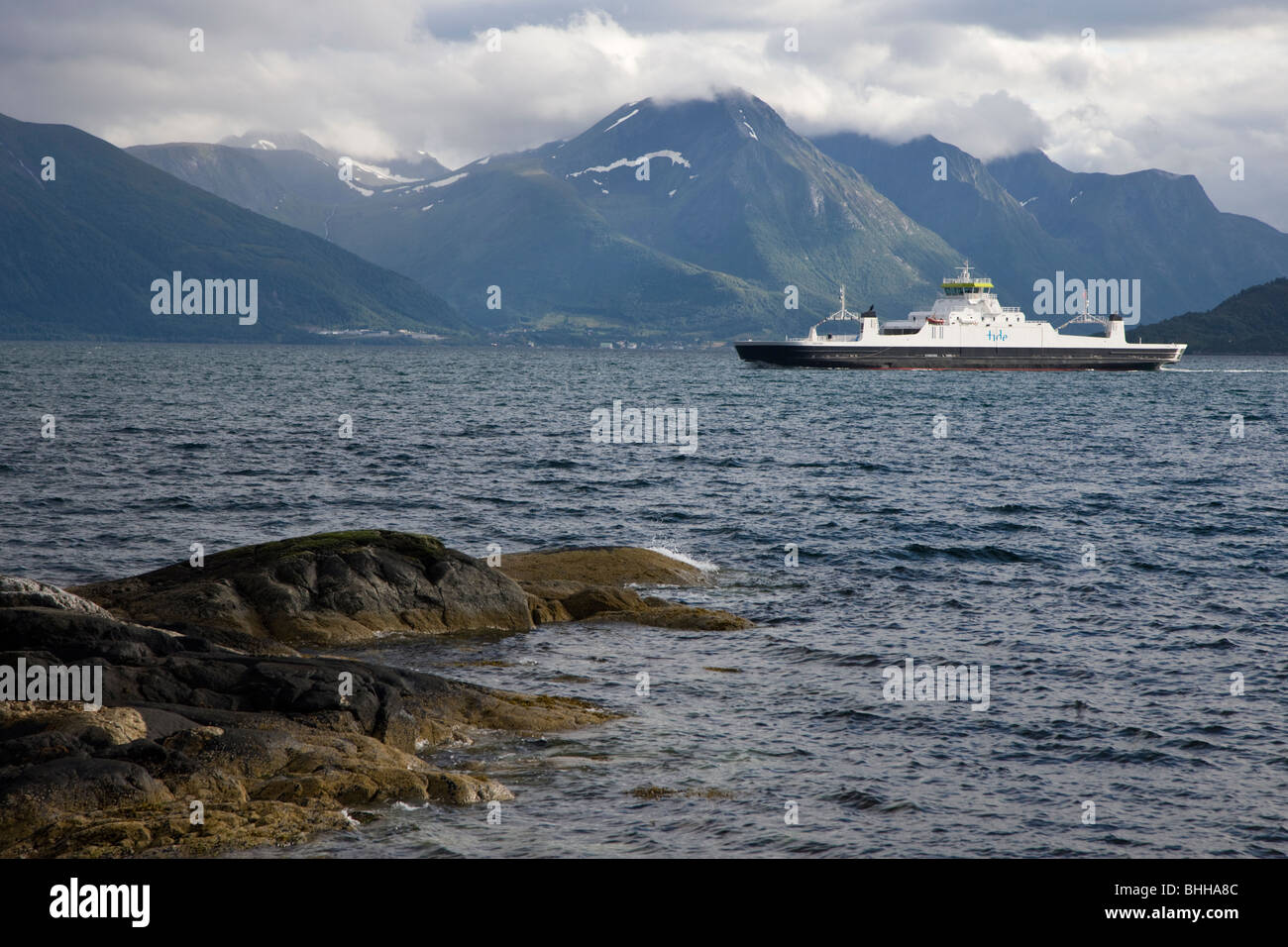 A ferry on a fiord in Norway. - Stock Image