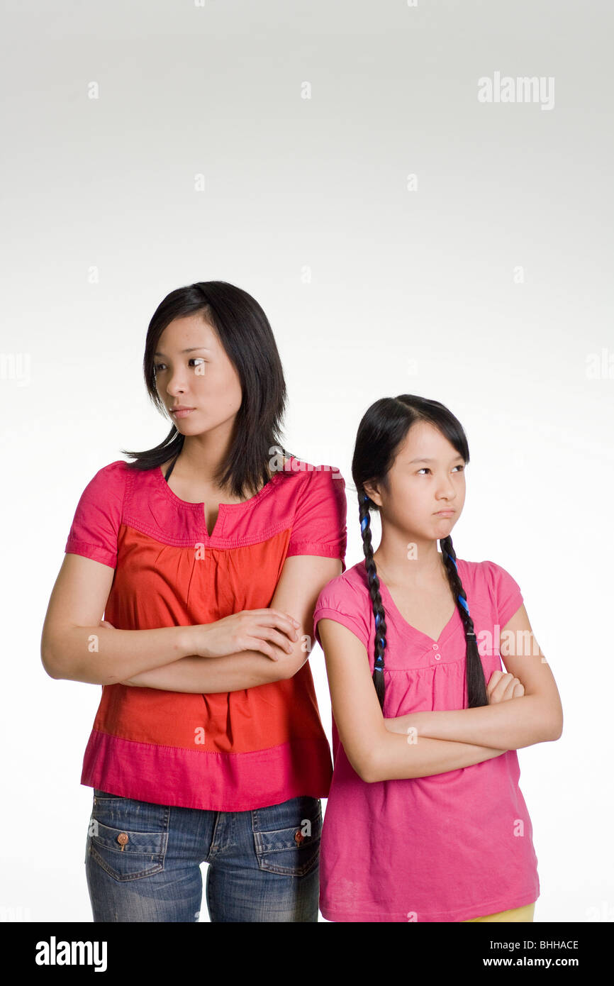 Woman and girl standing side by side. - Stock Image